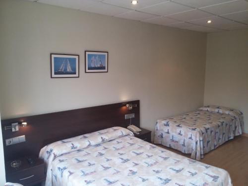 Cama o camas de una habitación en Hotel Náutico