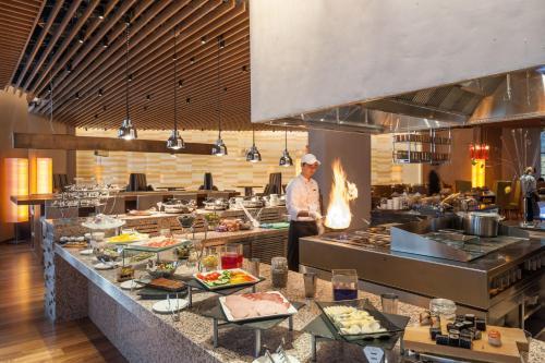 A restaurant or other place to eat at Rixos Khadisha Shymkent