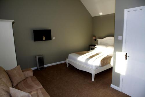 A bed or beds in a room at The Bull Inn Lodges