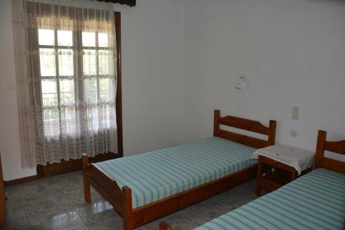 Ein Bett oder Betten in einem Zimmer der Unterkunft Elena - Kostas
