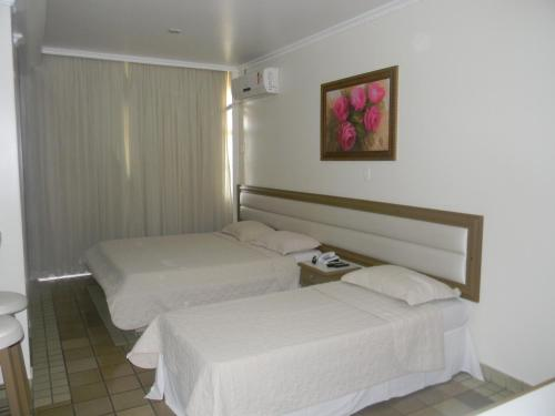 A bed or beds in a room at Hotel Slaass