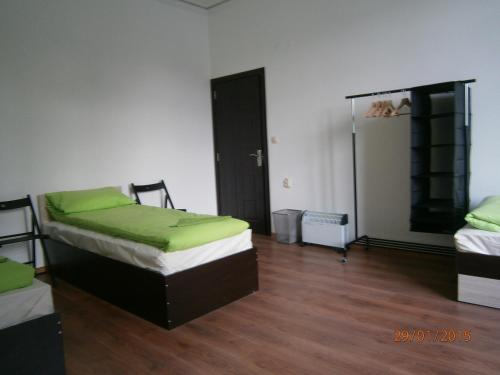 A bed or beds in a room at Ivory Tower Hostel