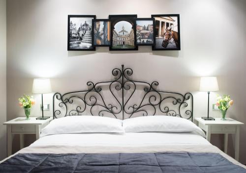 Ein Bett oder Betten in einem Zimmer der Unterkunft La Cupola del Vaticano