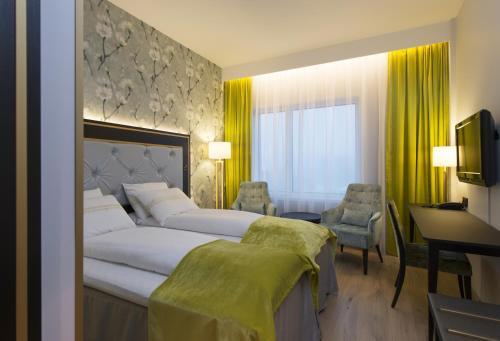 En eller flere senge i et værelse på Thon Hotel Opera