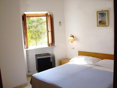 Letto o letti in una camera di Ludovica Apartment