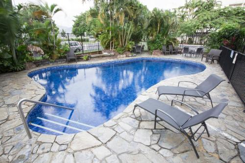 The swimming pool at or near Cairns Plaza Hotel