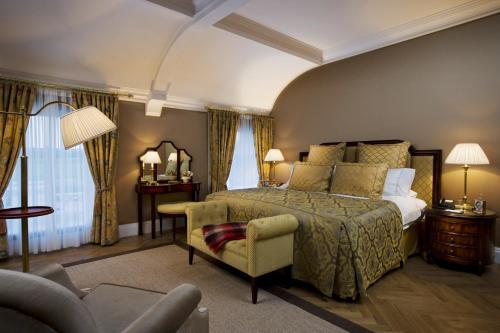 A bed or beds in a room at Castlemartyr Resort Hotel