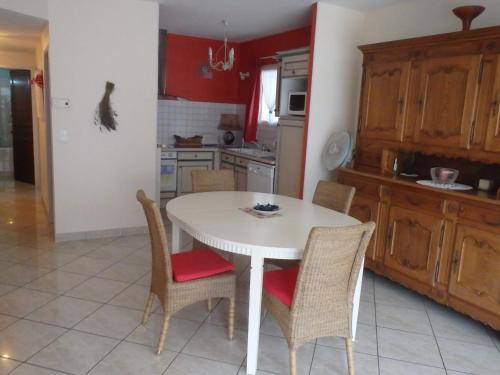 A kitchen or kitchenette at Le Moulin des Prés