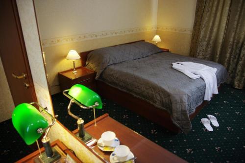 Кровать или кровати в номере Гостиница Гринъ