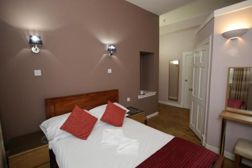 A bed or beds in a room at The Merchant City Inn
