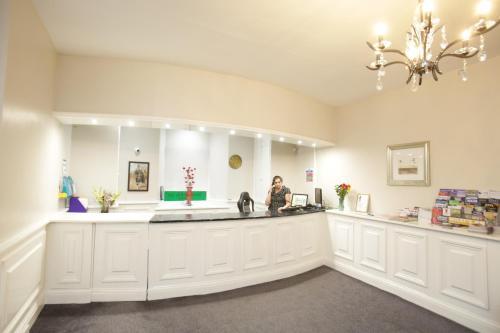 The lobby or reception area at The Merchant City Inn
