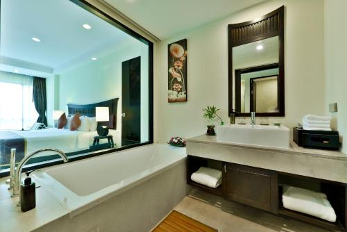 A bathroom at Bhu Nga Thani Resort & Spa - SHA Plus