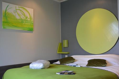 A bed or beds in a room at B&B A l'Essentiel