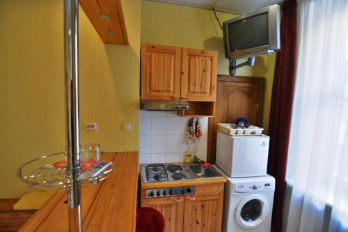 A kitchen or kitchenette at Hotel Multilux