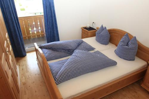A bed or beds in a room at Studlerhof