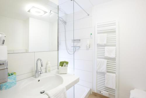 Ein Badezimmer in der Unterkunft Hotel Klingelhöffer