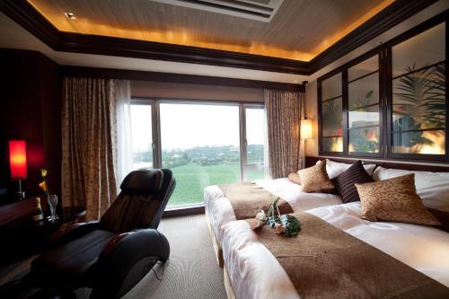 Ein Sitzbereich in der Unterkunft Hotel Coco Grand Ueno Shinobazu