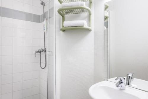 Een badkamer bij ibis budget Antwerpen Centraal Station