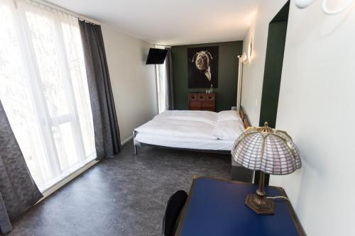 A bed or beds in a room at Hotel Landhaus