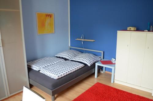 Ein Bett oder Betten in einem Zimmer der Unterkunft Quartier Ostheim