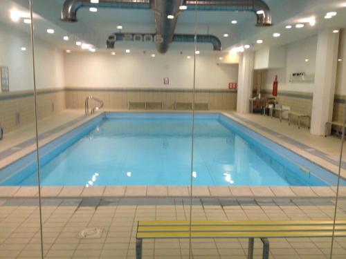The swimming pool at or near Appartamento Villaggio Olimpico