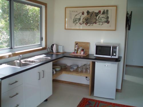 A kitchen or kitchenette at Phillip Island walk to beach