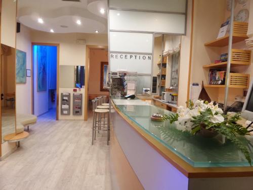 A kitchen or kitchenette at Hotel Astor