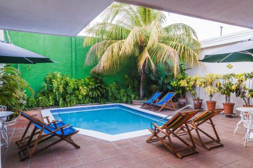 The swimming pool at or near Hotel El Almendro