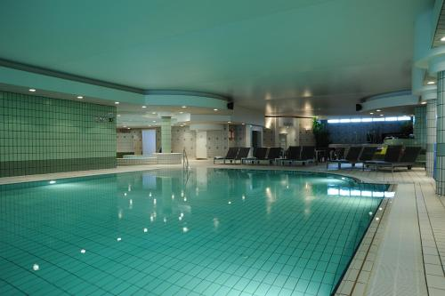 The swimming pool at or near Vayamundo Oostende - Apartments