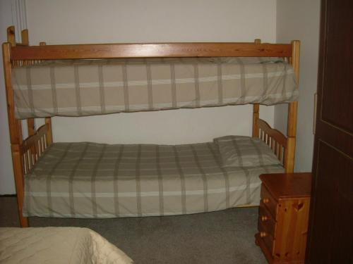 A bunk bed or bunk beds in a room at Thalatta Guest House