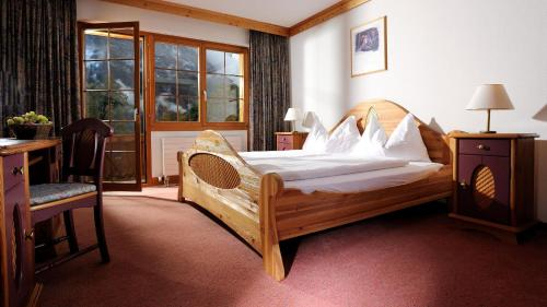 A bed or beds in a room at Das BODMI