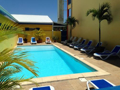 The swimming pool at or near Karaibes Hotel