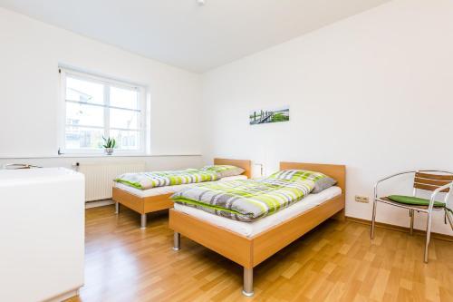 Ein Bett oder Betten in einem Zimmer der Unterkunft Apartments Bensberg