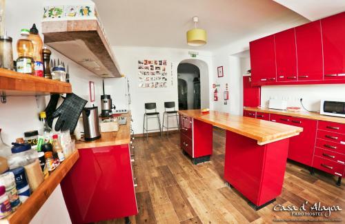 A kitchen or kitchenette at Hostel Casa d'Alagoa