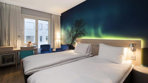 A bed or beds in a room at Thon Hotel Nordlys