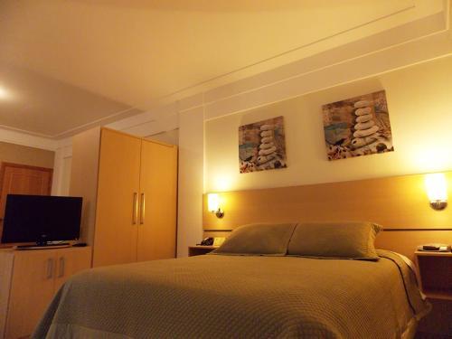 Кровать или кровати в номере Itajubá Flat Hotel
