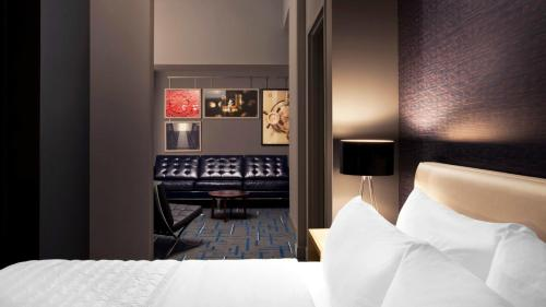 A bed or beds in a room at Le Méridien Tampa