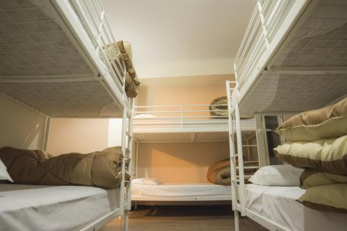 A bunk bed or bunk beds in a room at Pella Inn Hostel