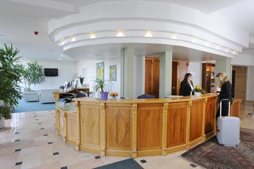 The lobby or reception area at AXXON Hotel