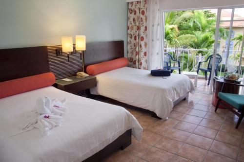 Ein Bett oder Betten in einem Zimmer der Unterkunft VH - Gran Ventana Beach Resort