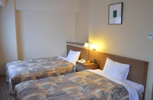A bed or beds in a room at Yokohama Mandarin Hotel