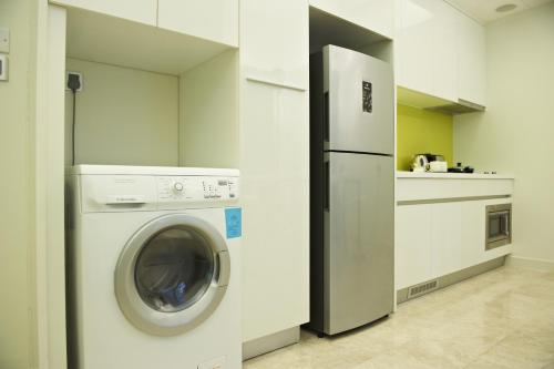 A kitchen or kitchenette at The Signature Hotel & Serviced Suites Kuala Lumpur