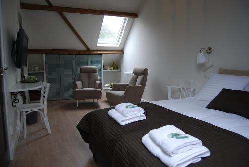 Een kamer bij Bed & Breakfast Langlaar