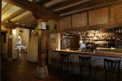 El salón o zona de bar de Posada el Zaguan