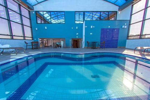 The swimming pool at or close to Plaza Inn Breeze Aeroporto