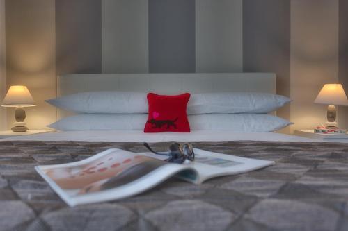 Кровать или кровати в номере Tritone Top House