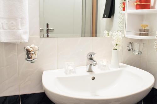Ванная комната в Hotel Rex