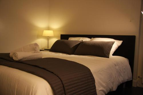 Een bed of bedden in een kamer bij B&B Keizers Canal