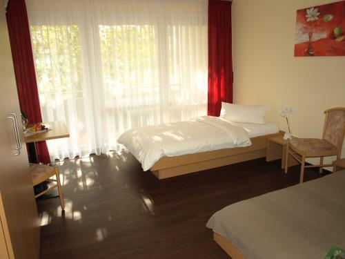 Ein Bett oder Betten in einem Zimmer der Unterkunft Boardingroom
