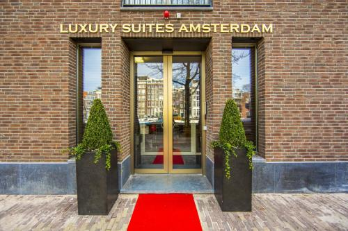 The facade or entrance of Luxury Suites Amsterdam - Member of Warwick Hotels